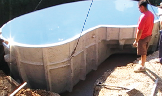 Backfill around polyester shell pool