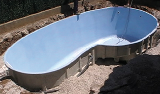 Positioning of polyester shell pool